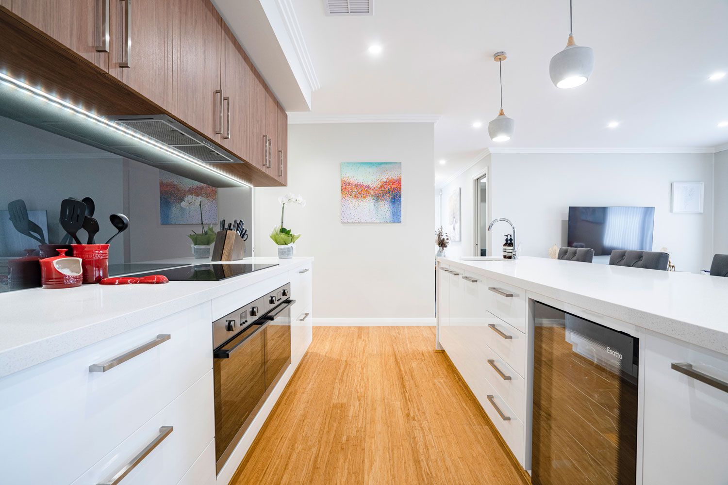 custom kitchen with bamboo flooring and stone bench tops