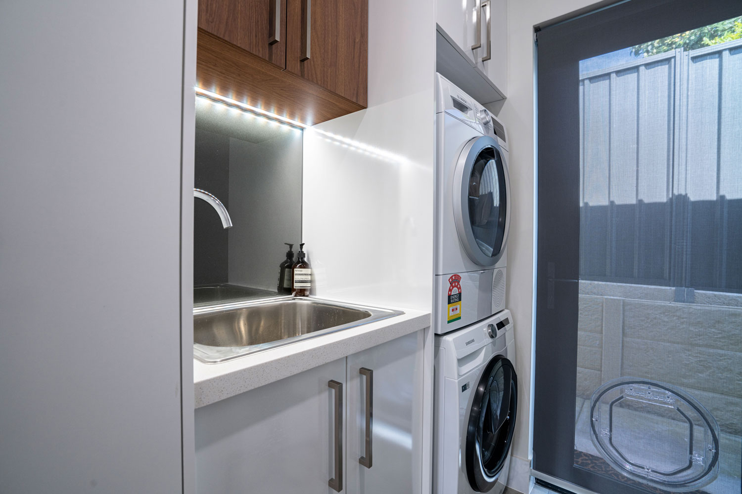 luxury bathroom with stacked washer and dryer